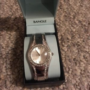 Round diamond bezel silver bangle watch